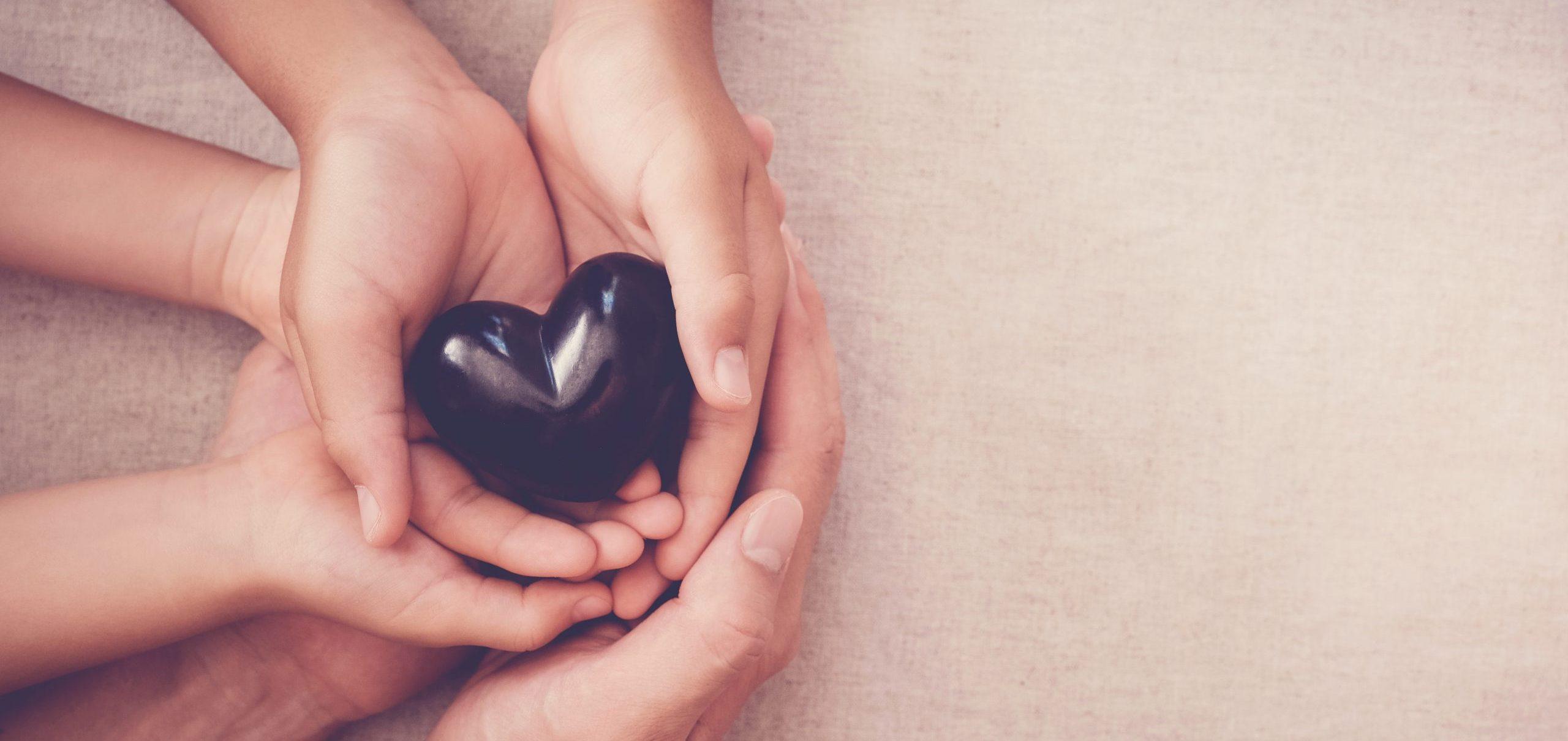 hands and red heart, health insurance, mending broken family