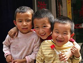 three small children smiling