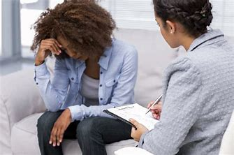 distressed woman sitting in front of a therapist